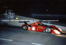 Ferrari 333SP Goosens/van der Peole/Bachelart . Photo. Le Mans 1996 pit exit at night.